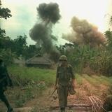 US Marines Walk Away from Blown Up Viet Cong Base, May 1966
