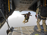A U.S. Air Force Pararescueman Jumps Out of An HC-130P Combat King Aircraft