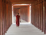 Monk in Walkway of Wooden Pillars To Temple, Salay, Myanmar (Burma)