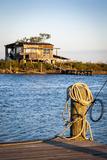Dock and House across Bayou Petit Caillou, Cocodrie, Louisiana, USA