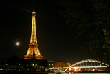 Night View of the Eiffel Tower, the Crescent Moon, and a Nearby Bridge