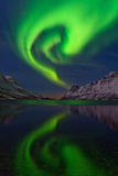 The Aurora Borealis, or Northern Lights, Swirl over a Fjord