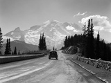 1930s Sedan Automobile Driving High Mountain Road Towards Snow Capped Mount Rainier