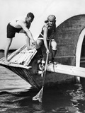 1920s Man and Woman in Bathing Suits Crabbing Off Old Abandoned Wooden Boat