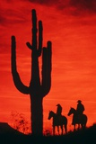 1980s Silhouette of Two Anonymous Cowboys Riding on Horseback