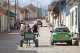 Horse and Cart and Vintage American Car on Cobbled Street in the Historic Centre of Trinidad