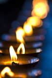 A Candle Flickers in a Brass Butter Lamp in the Prayer Room of an Ancient Buddhist Monastery