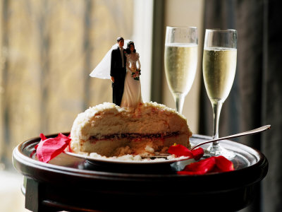 Elegant Table Setting with Traditional Wedding Cake Toppers and Glasses of
