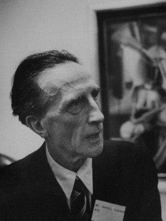 Artist Marcel Duchamp Attending A Texas Art Show photo
