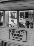 Man Waiting in a Barber Shop For a Haircut