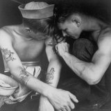 American Sailor Having Another Tattoo Done by Shipmate Aboard Battleship USS New Jersey During WWII