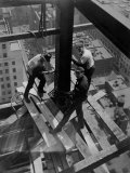Workmen Attach Steel Beams Above Street During Construction of the Manhattan Company Building