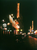 Neon Lights Lit at Night for Clubs and Hotel de Paris on Street in Monmartre Section
