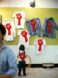 T Shirts Bearing a Red Fist Symnolizing Support of a Student Strike at Harvard University