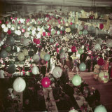 Crowds of People Dancing under Balloons at a Debutante Party