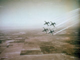 US Navy Stunt Pilots of the Blue Angels Flying their F9F Jets During an Air Show