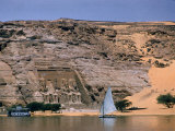 Boats on Nile River Passing Massive Statues of Pharoh Ramses II at Door to Queen Nefertari's Temple