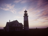 Golden Sunset at Nantucket  Mass with Sankaty Head Lighthouse Silhouetted Against Sky