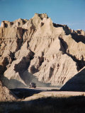 Car Driving Through Rocky Landscape in Badlands National Park