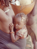 African Child Being Carried by Her Mother