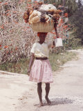 Haitian Woman Carrying Large Basket with Her Market Shopping on Her Head