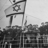 Jewish Immigrants  Arriving in Haifa Aboard Refugee Ship  Waving Future Flag of the State of Israel