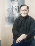 Kung Teh Cheng Seated before Portrait of Ancestor