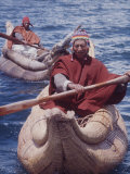 Indian Fishermen in Colorful Knit Hats Row across Lake Titicaca in Totora Boats Made of Reeds  Peru