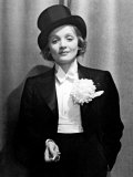 Actress Marlene Dietrich Wearing Tuxedo  Top Hat  and Holding Cigarette at Ball for Foreign Press