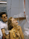 Teenage Girl and Boy on a Sailboat