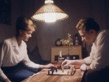 Young East German Couple Playing a Game of Chess at Home