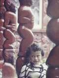 Young Maori Girl Amid Totems in New Zealand