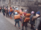 School Children Walking to School with Book Bags on their Backs  East Germany