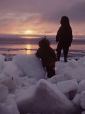 Alaska: Silhoutte of Native Alaskan Children Watching the Midnight Sun