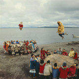 Native Alaskans Playing a Game of Nulukatuk  in Which Individals are Tossed into the Air