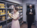 First Lady Mamie Eisenhower Looking over Canned Stock with Major-Domo Charles Ficklin