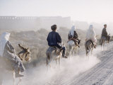 Russian Look of the Land Essay: Donkeys Carring Moslem Peasants on Dusty Road