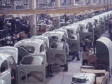 White Volkswagens Coming Down Assembly Line in Brazilian Factory