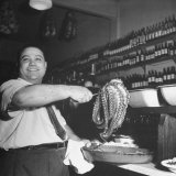 Cook in the Napoli Restaurant Holding up an Octopus  a Delicacy in Argentina