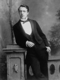 Elgant Young Man Posing for Studio Portrait Attired in Black Tie and Tails