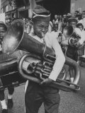 Young Boy Playing the Tuba During the Parade