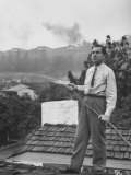 Senator Richard M Nixon on Roof of Home in Los Angeles  Putting Out Fires Caused by Brush Blaze