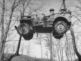 Group of Us Soldiers Pulling a Jeep over a Ravine Using Ropes while on Maneuvers