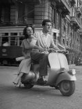 Man and Woman Riding a Vespa Scooter