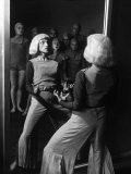 Costumed Dancer at the Truempy Dance School Performing in Front of a Mirror