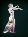 Actress Marilyn Monroe Wearing Gold Gown Designed by Bill Travilla for &quot;Gentlemen Prefer Blondes&quot;