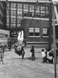 Child on Swings in Playground at the KLH Day Care Center