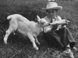Little White Goat Being Fed from Bottle by Little Boy  at White Horse Ranch