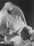 Nun Feeding an Elderly Patient