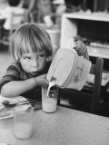 Child Pouring a Glass of Milk at Day Care